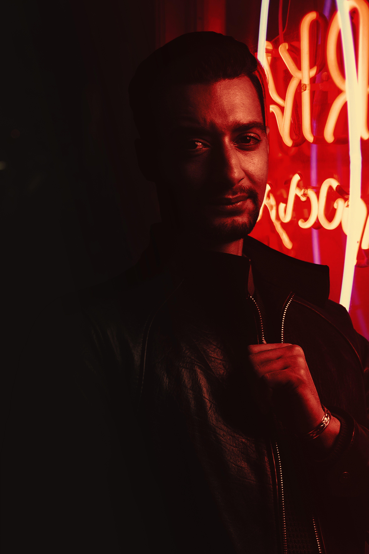 Man Standing Near Red Lights