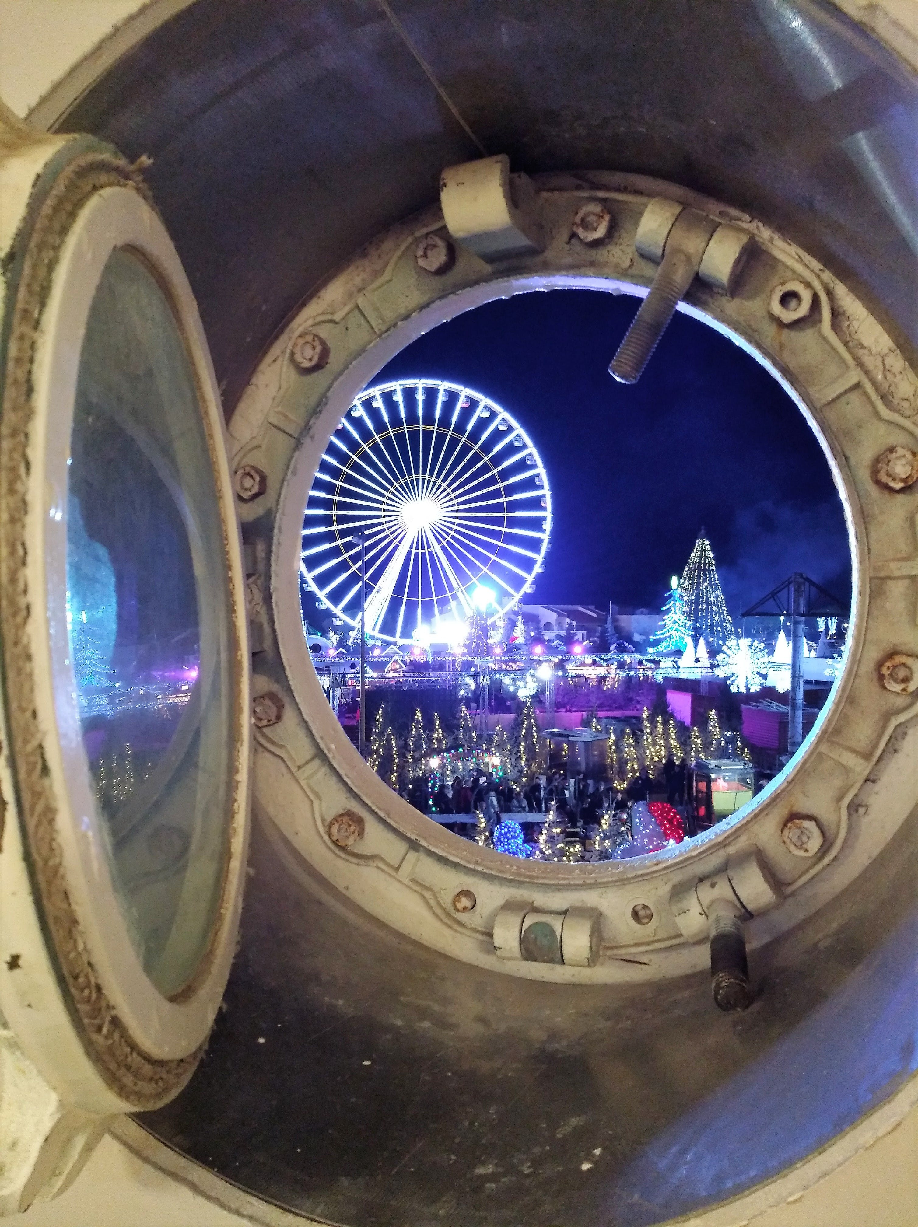 Free stock photo of Celebrations from a boat's porthole perspective