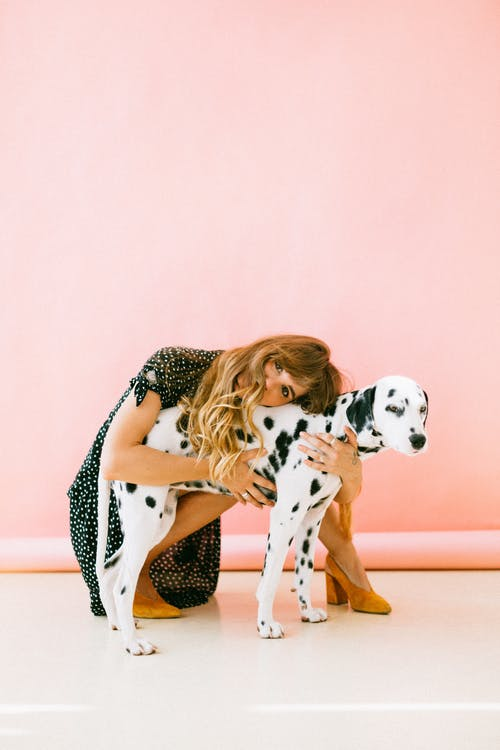 Woman Hugging Dalmatian