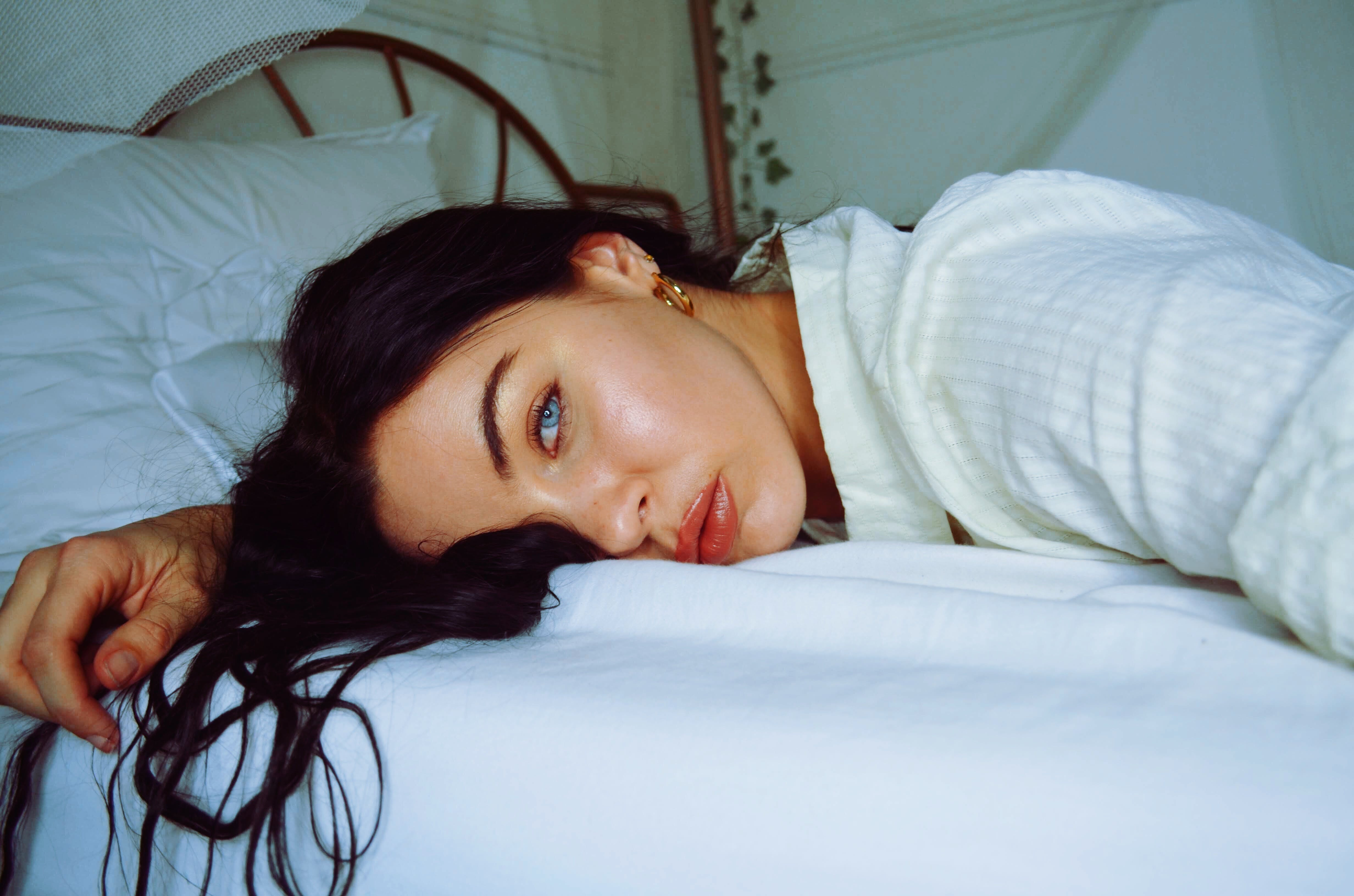 Close-Up Photo of Woman Lying on Bed