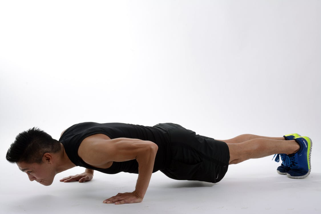Man Push-up on White Floor