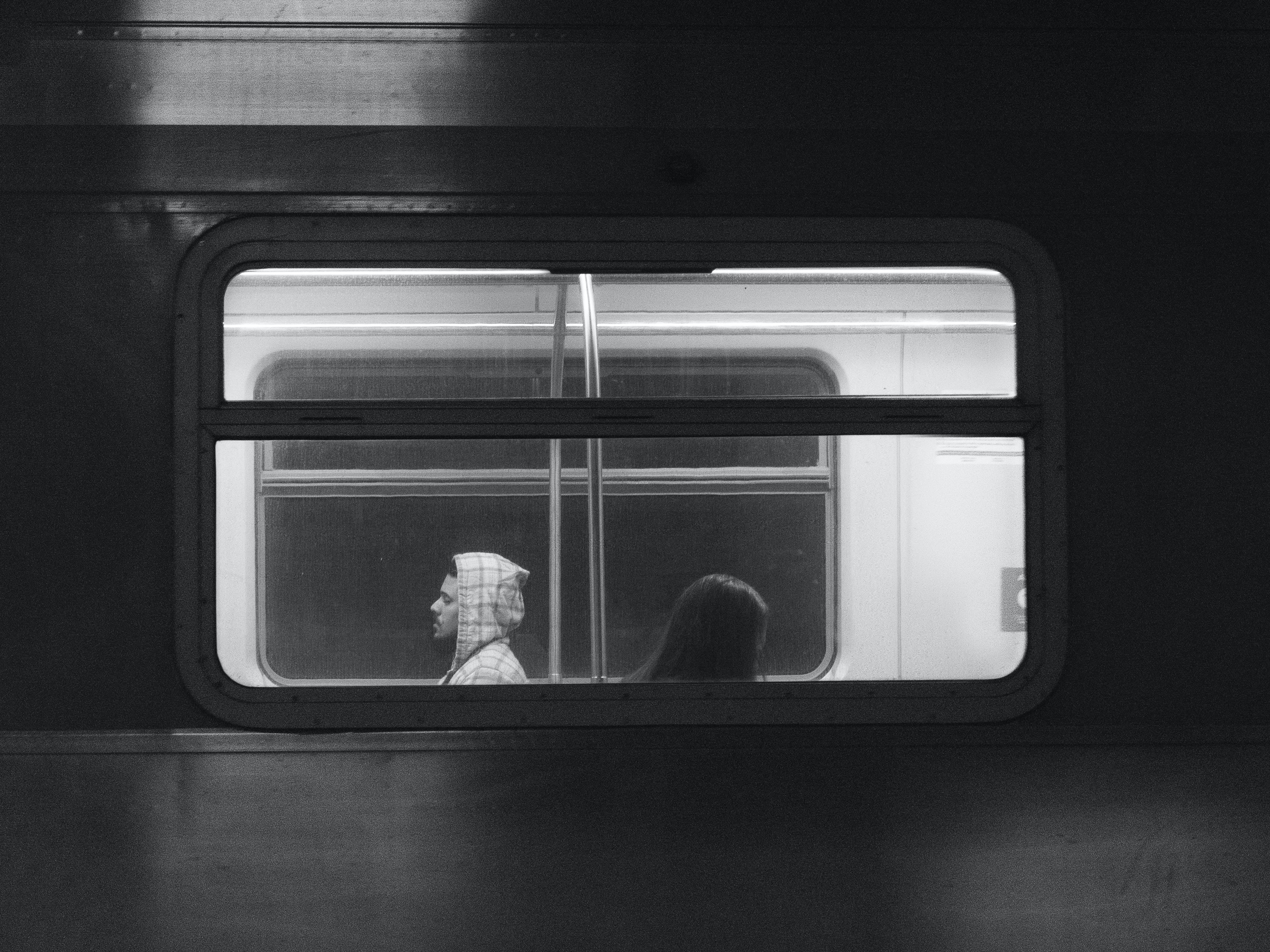 People Riding The Train
