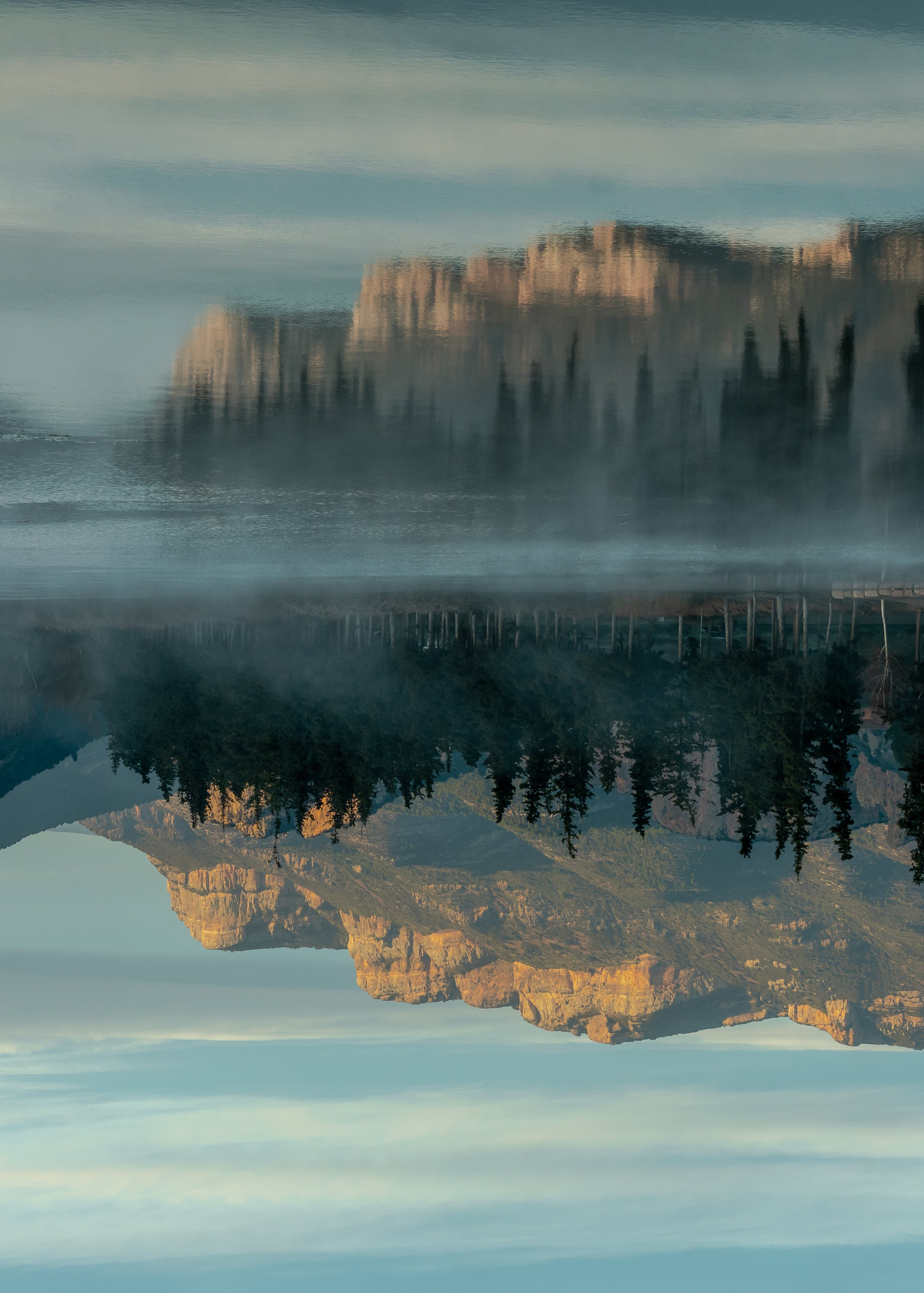 Photo of Reflection of Rocky Mountain and Trees