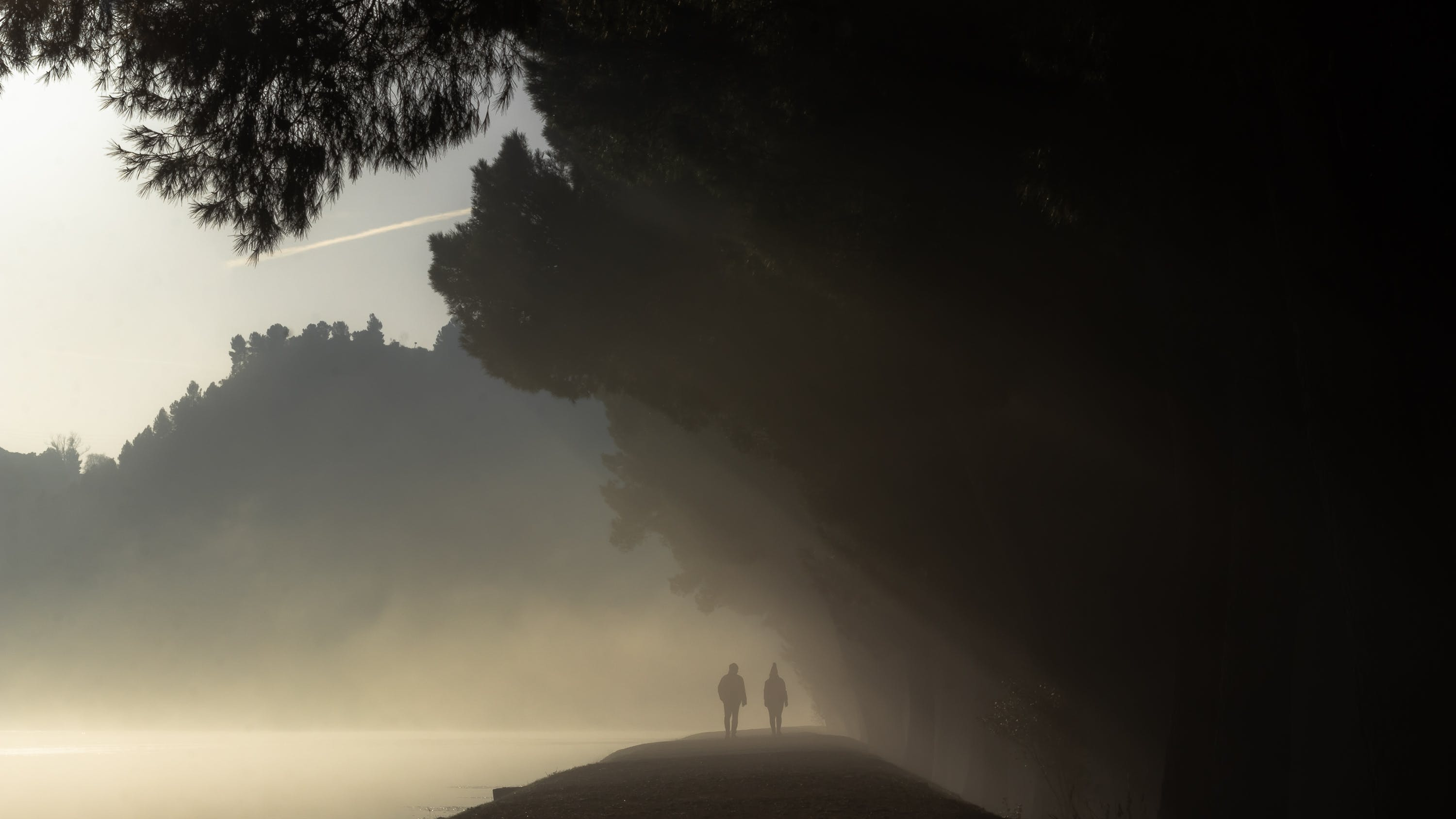 Silhouette of People on Cliff