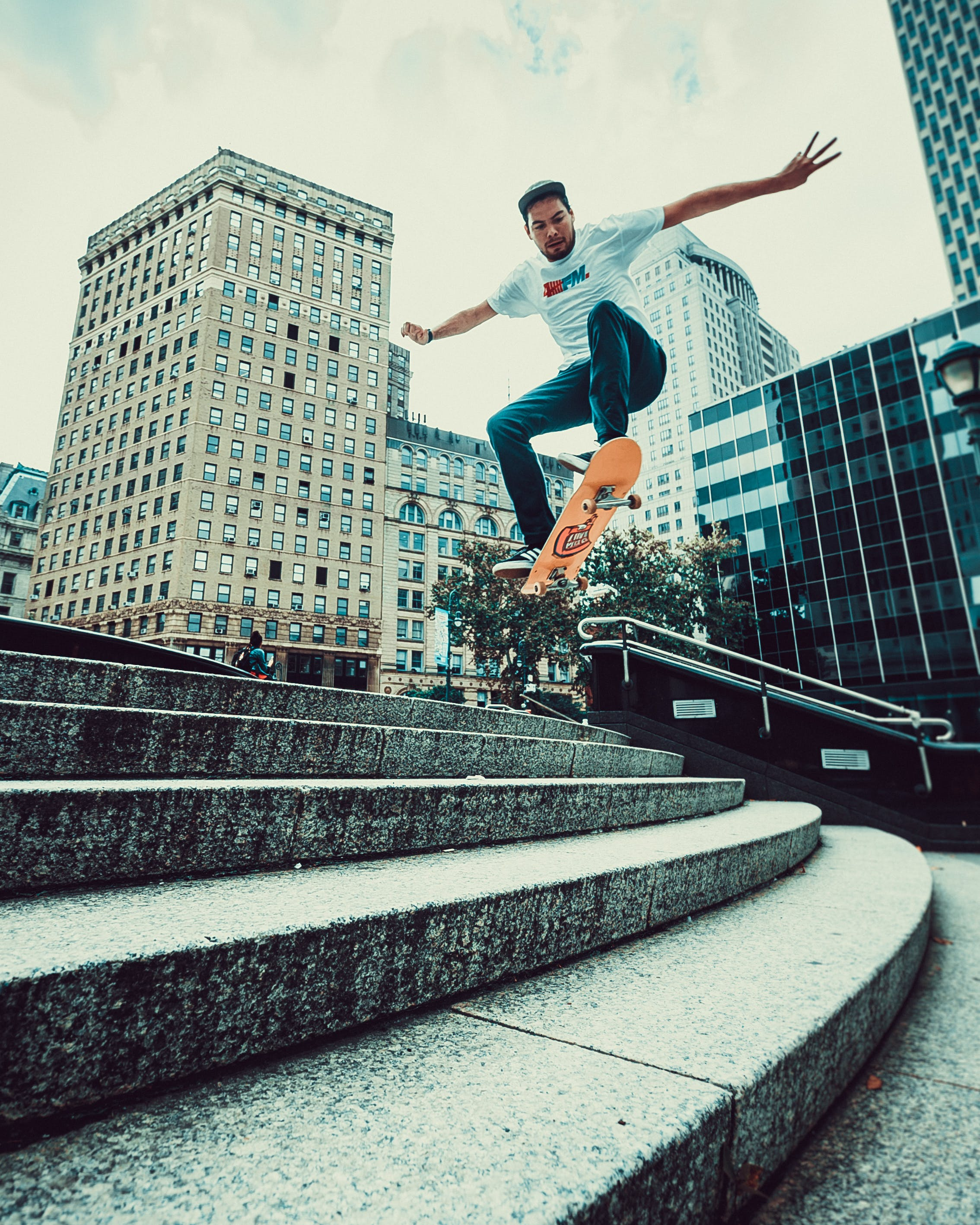 Man Riding Skateboard Doing Tricks On Stairs
