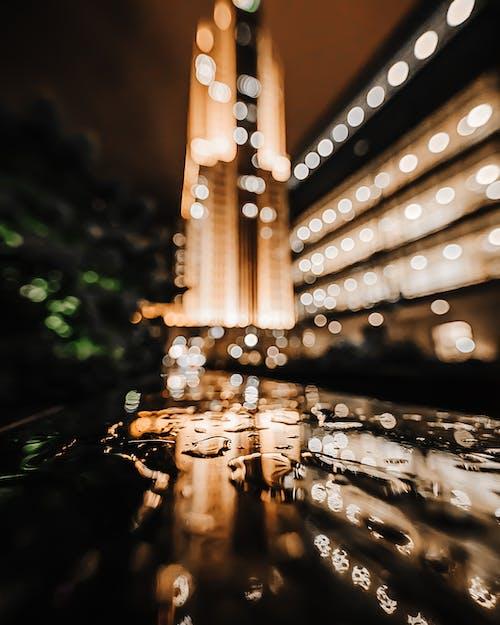 Kostenloses Stock Foto zu abend, architektur, beleuchtung, defokussiert