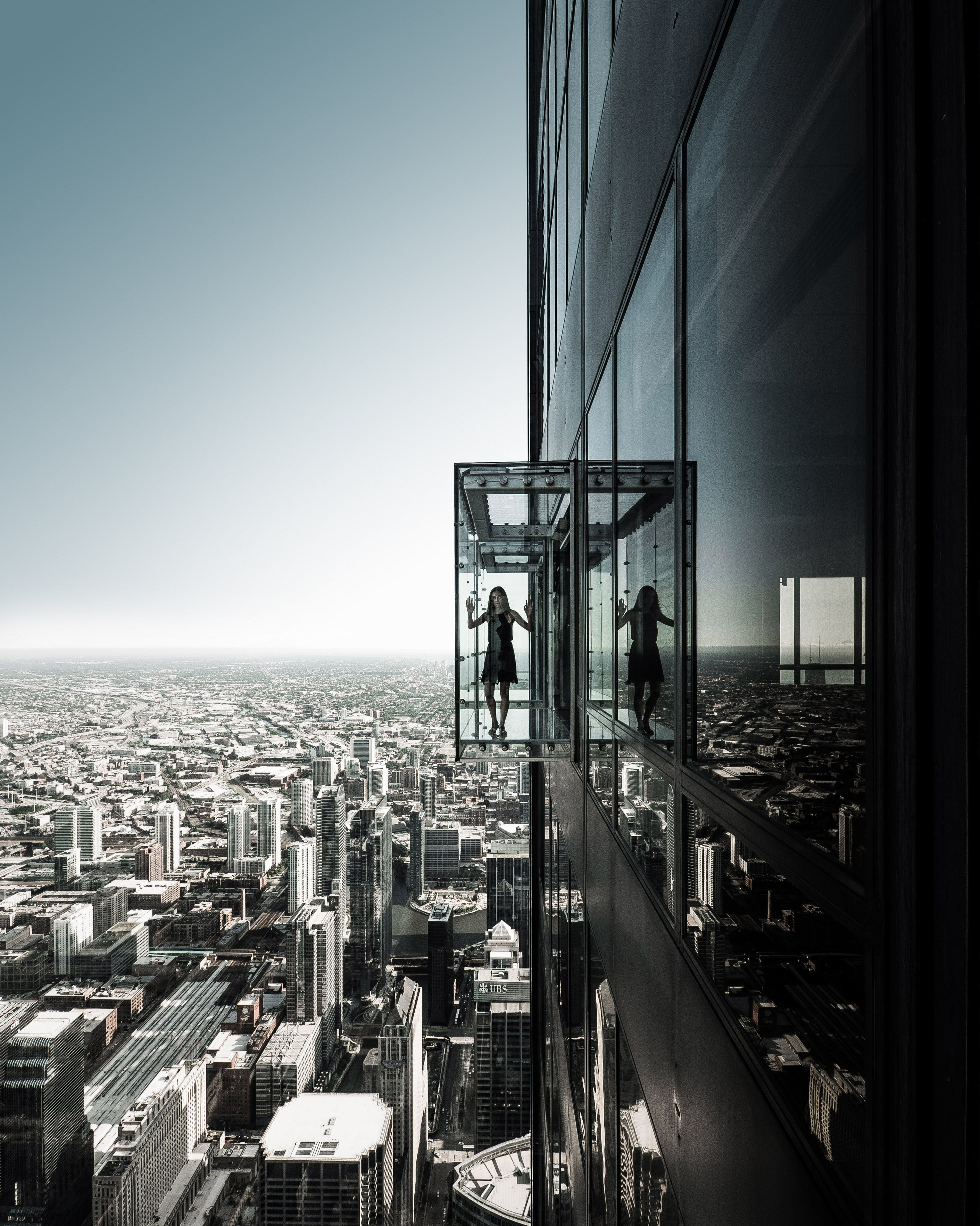 Grayscale Photo of Girl on Building Elevator