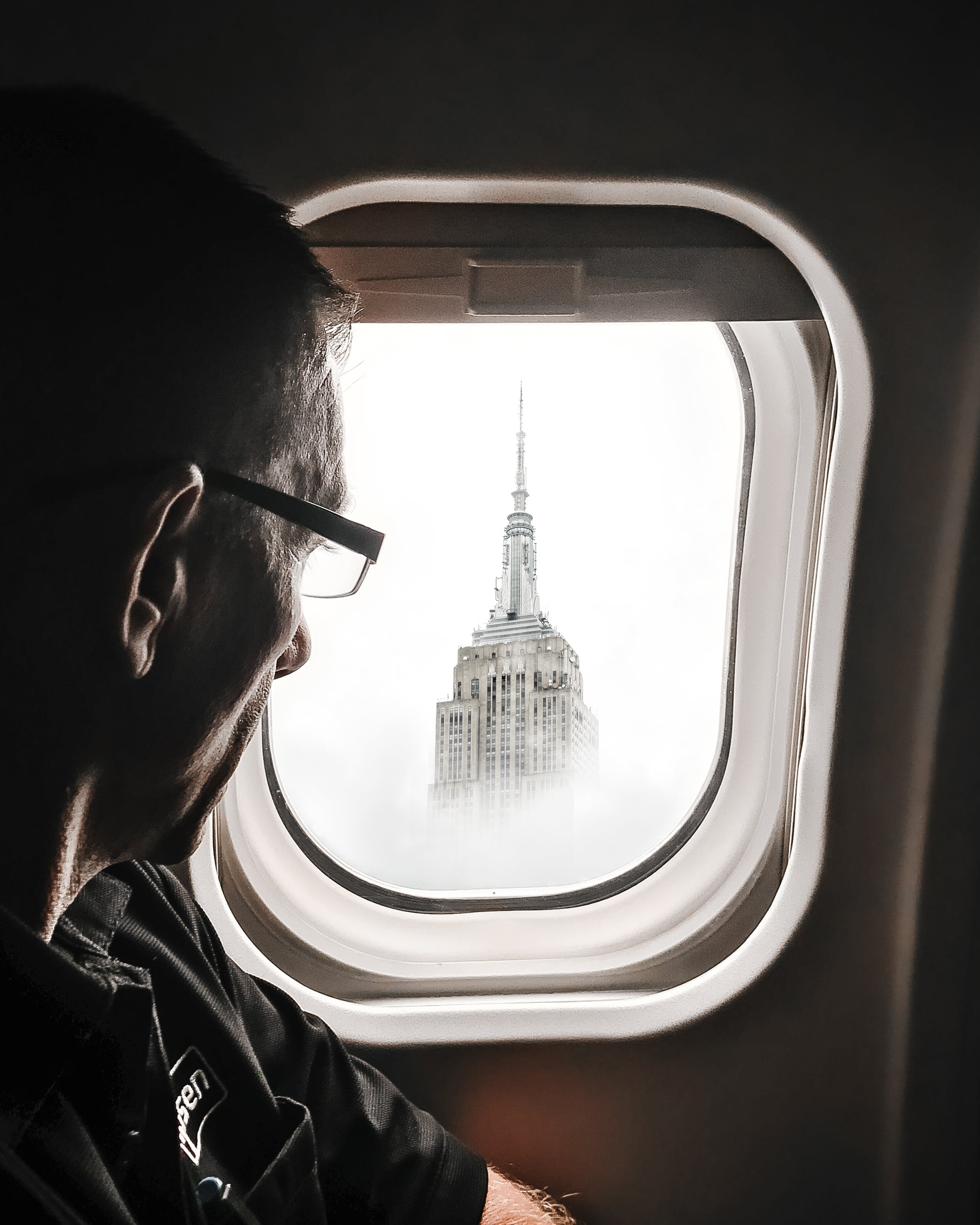 Man Looking Out Aircraft Window