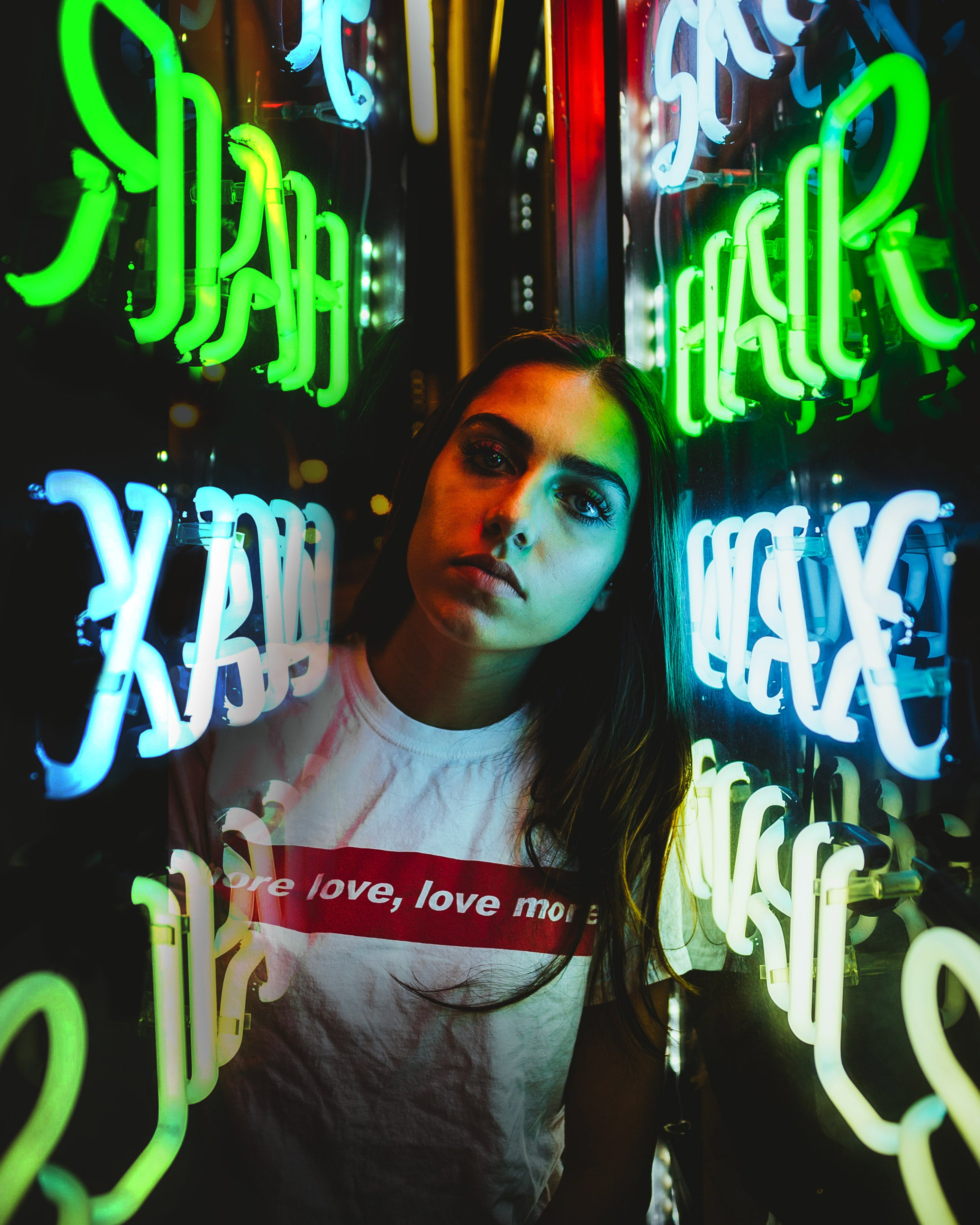 Woman in the Middle of Neon Signage
