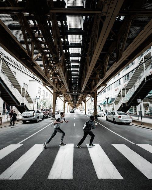 Two Men Crossing On Pedestrian Lane