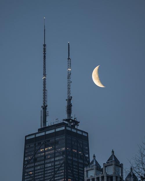Building Under Crescent Moon