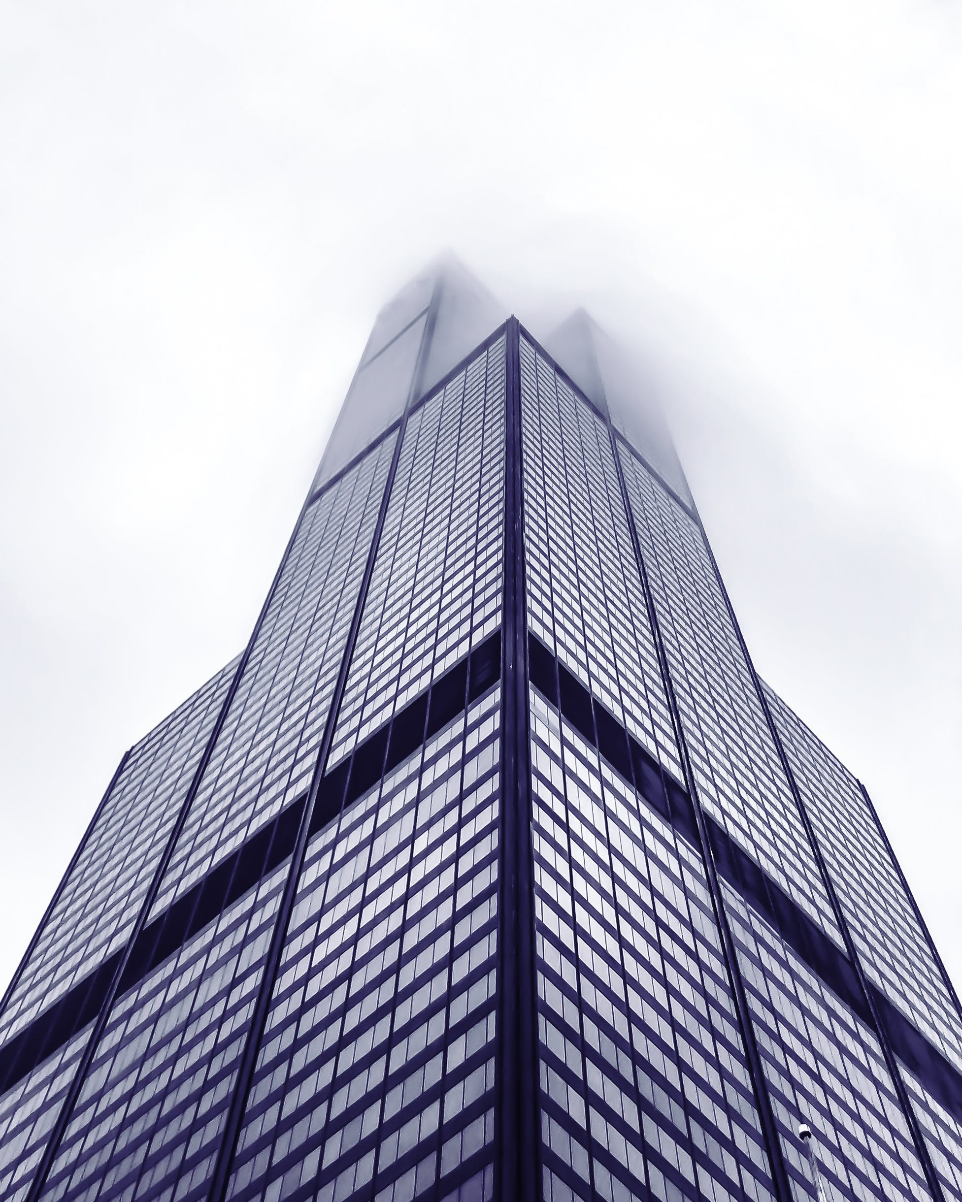 Low Angle Photo of The Willis Tower Covered With Fog
