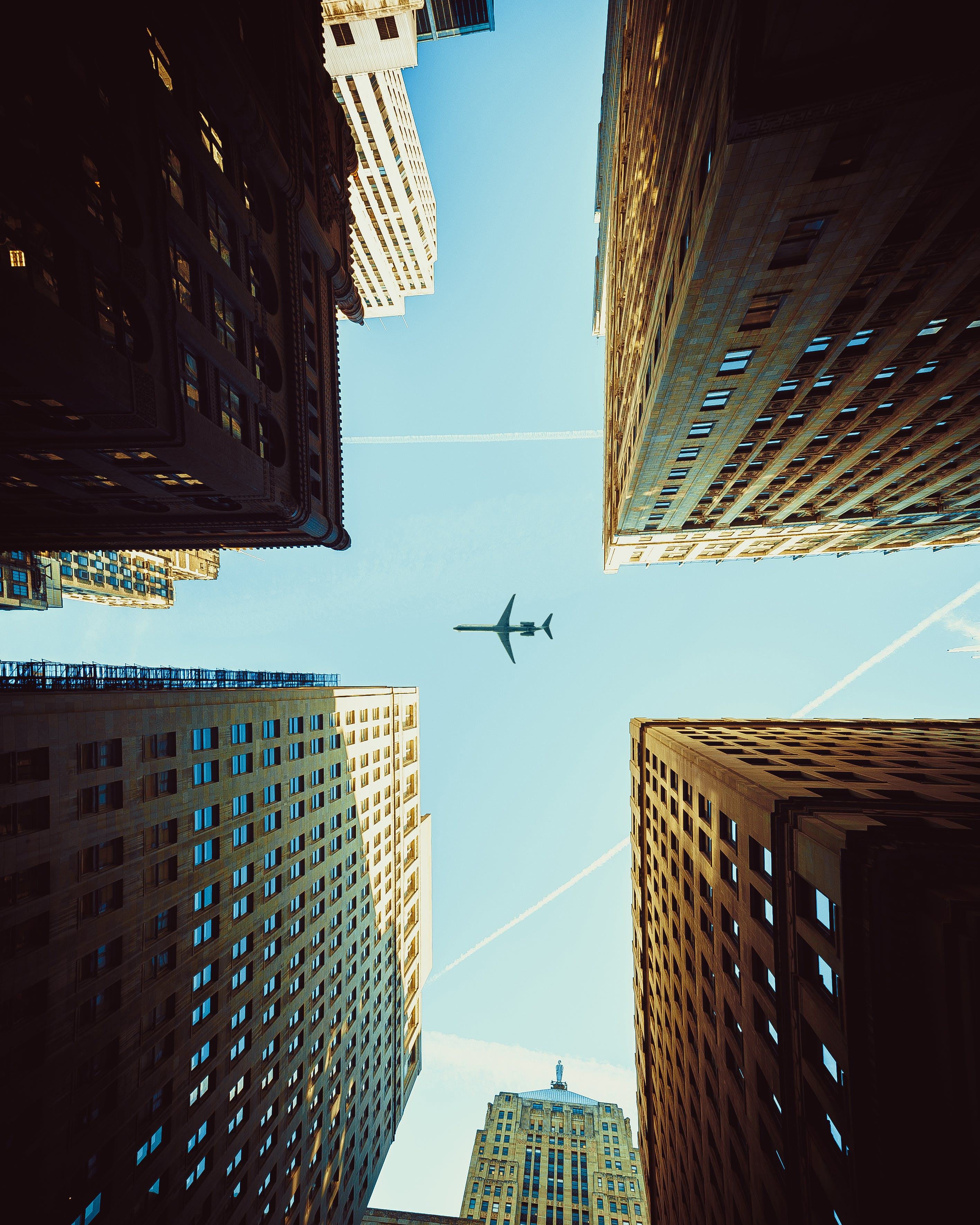 Worm's Eye View Photography Of Airplane And Buildings