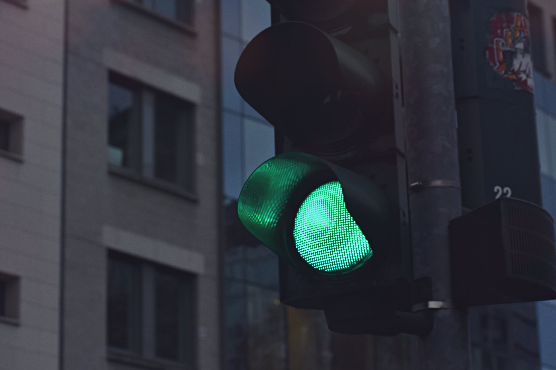 Black Traffic Light Displaying Green Go Signal