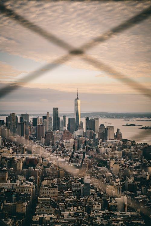 Foto stok gratis gedung tinggi, kota, matahari terbenam, new york