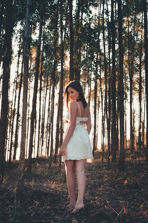 Woman Standing Behind Trees