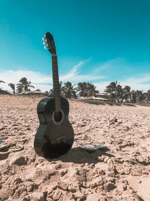 Guitar On Sand