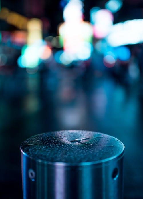 Round Silver Portable Speaker With Bokeh Photography