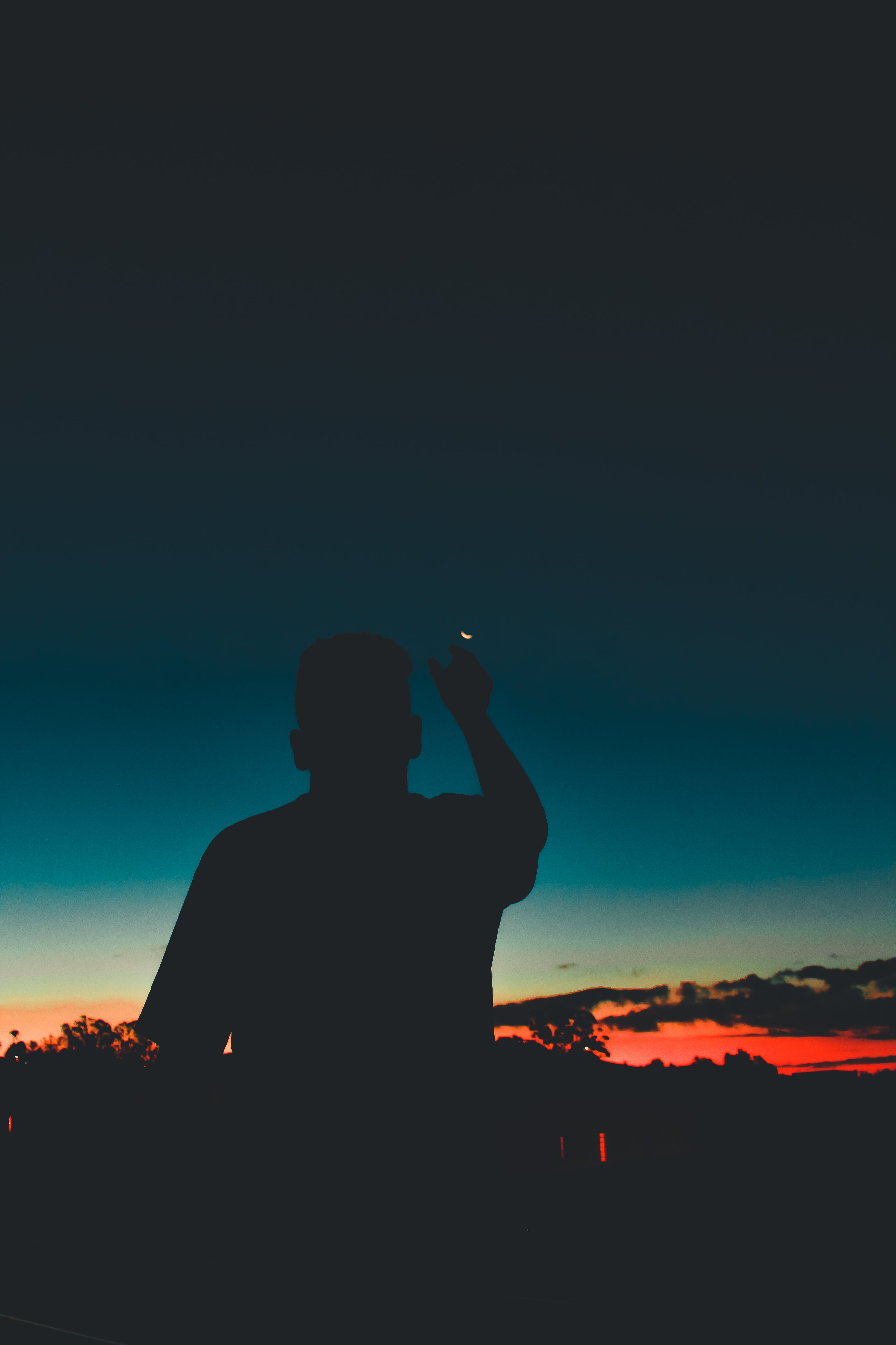 Silhouette Of Man Pointing Moon