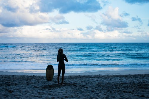 Person Standing Near Seashore