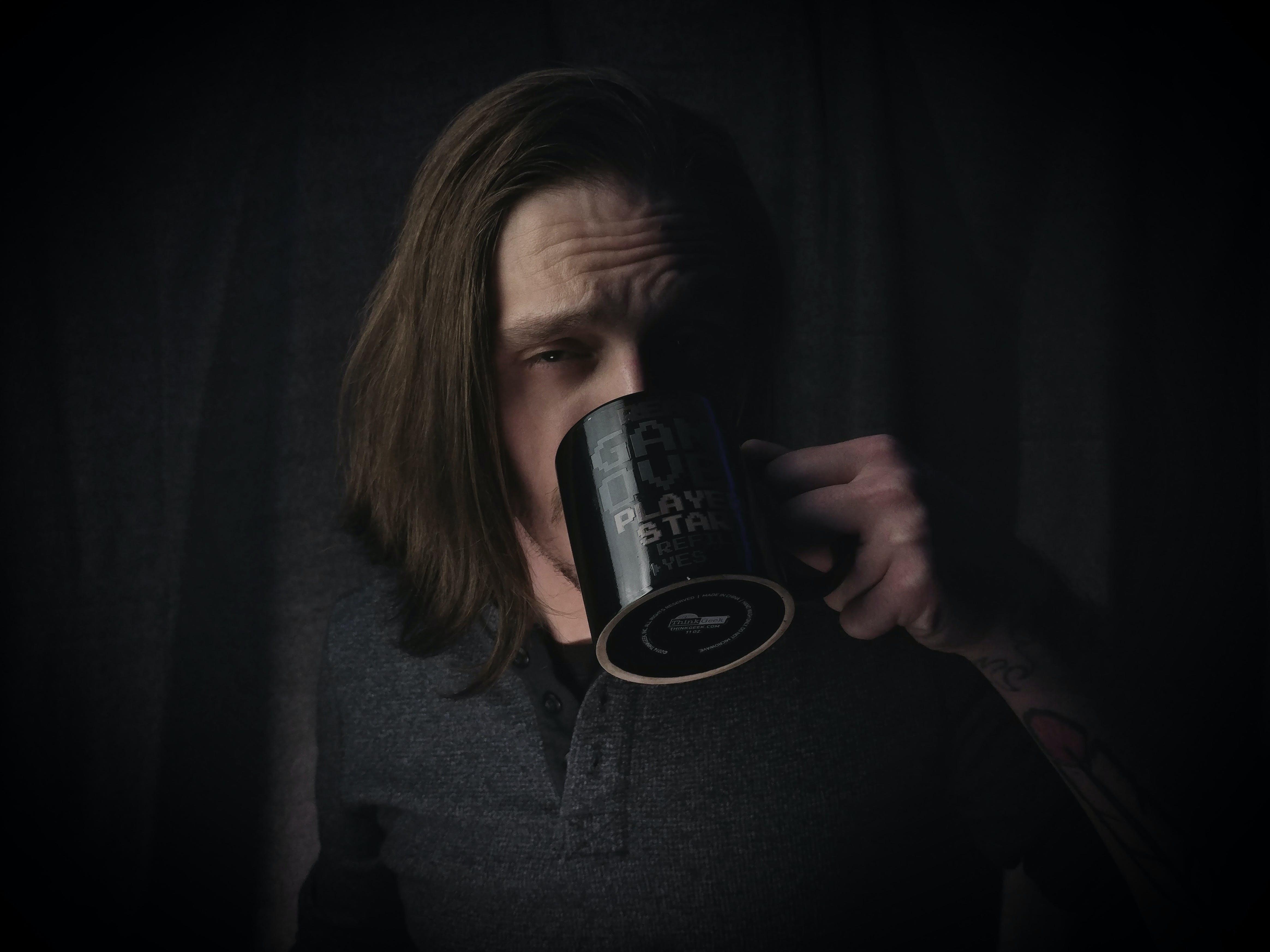 Man Wearing Black Dress Shirt Holding Black Ceramic Mug