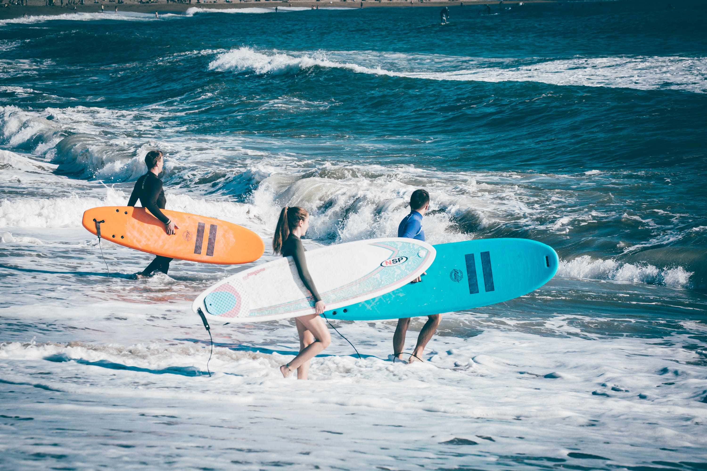 Three People About To Surf