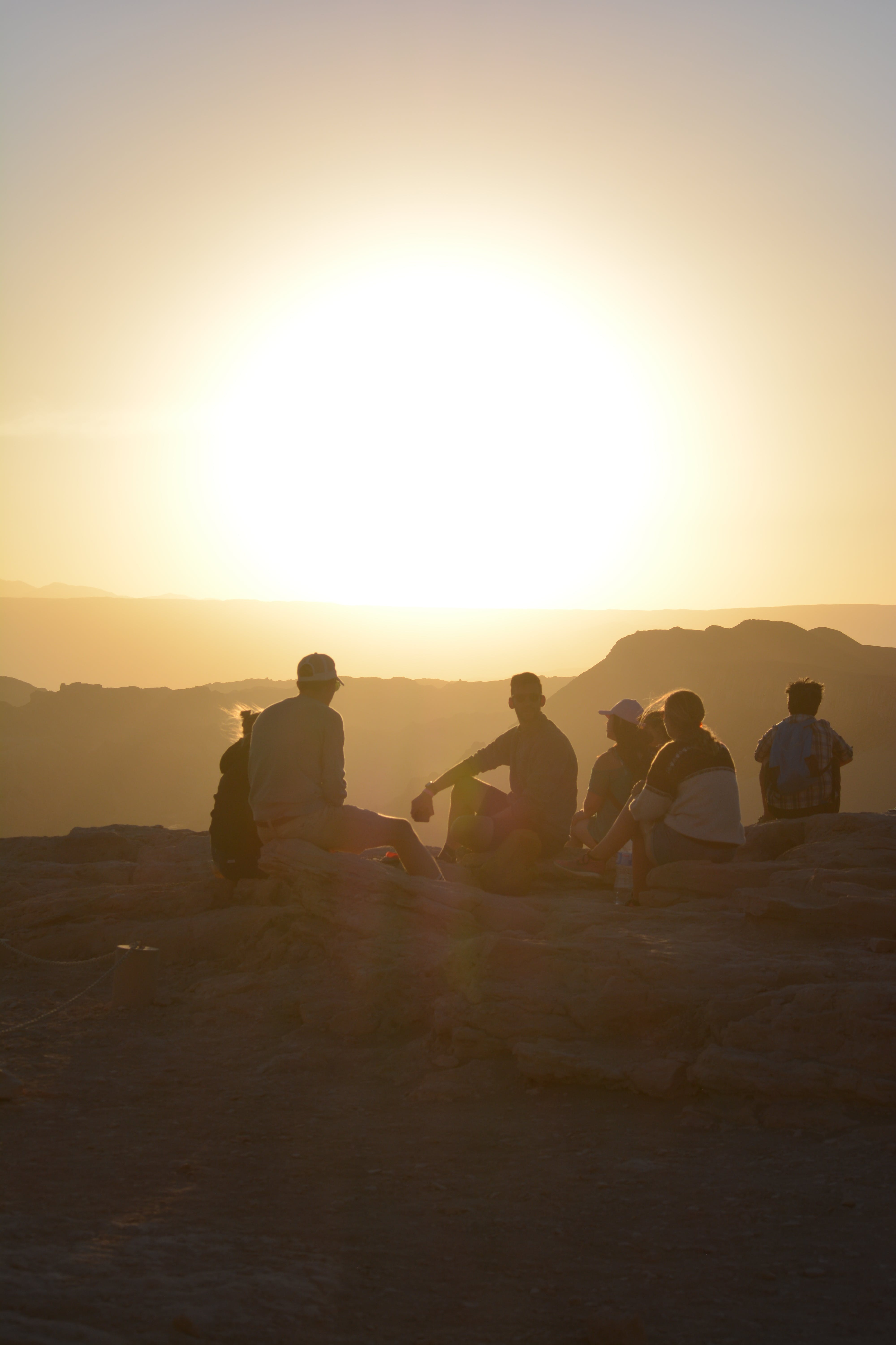 Group of People Near Mountain during Golden Hour