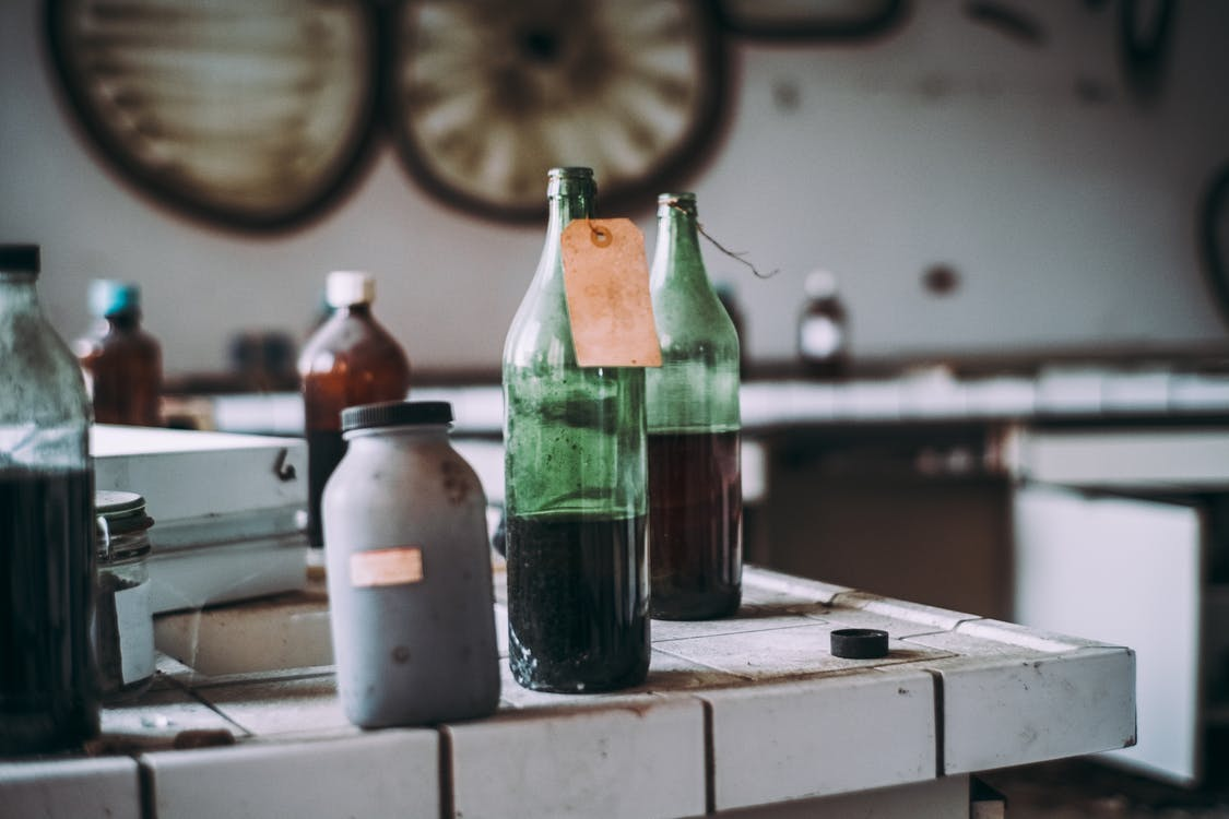 Selective Focus Photography of Filled Bottles