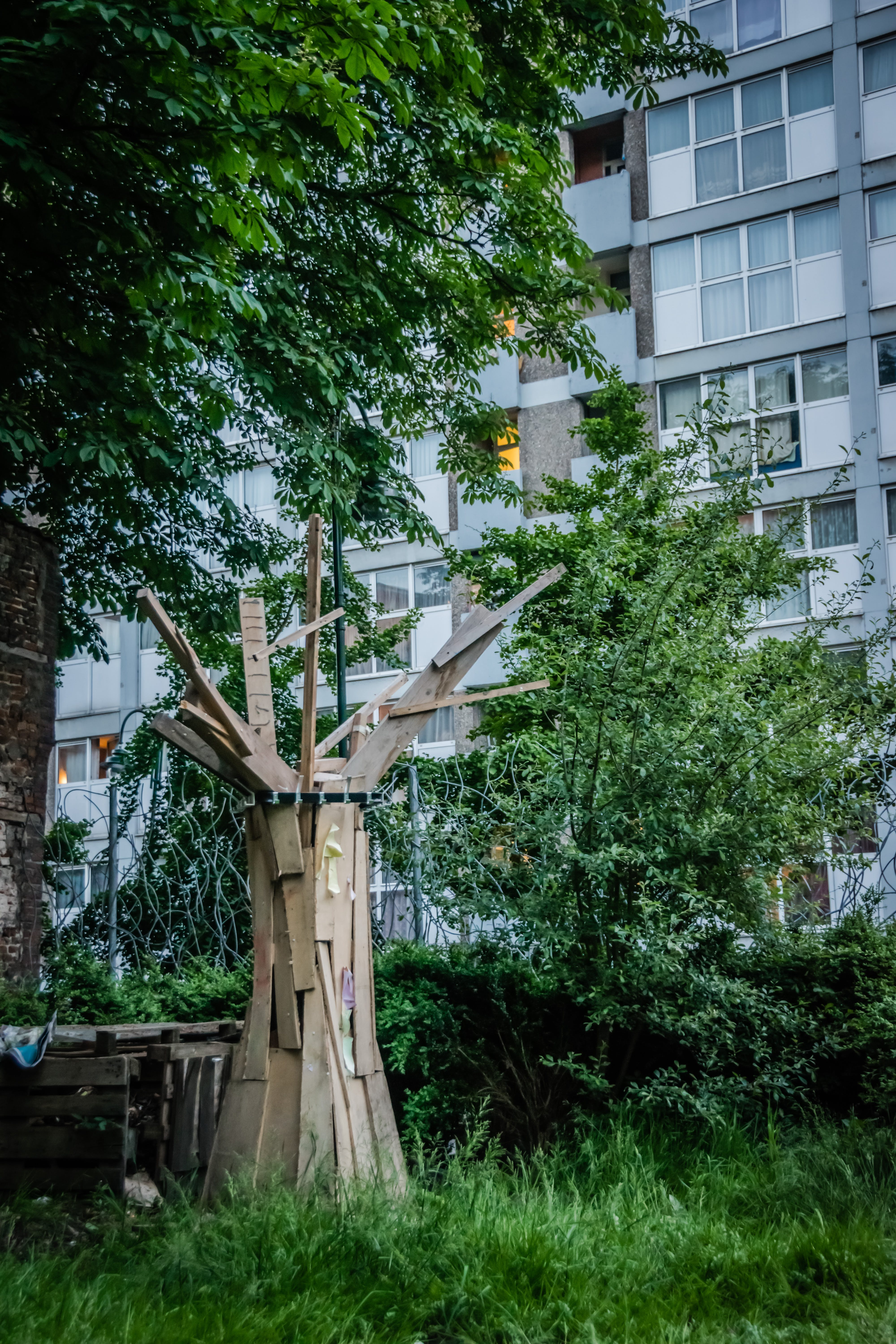 Wooden Sculpture Near Tree during Day