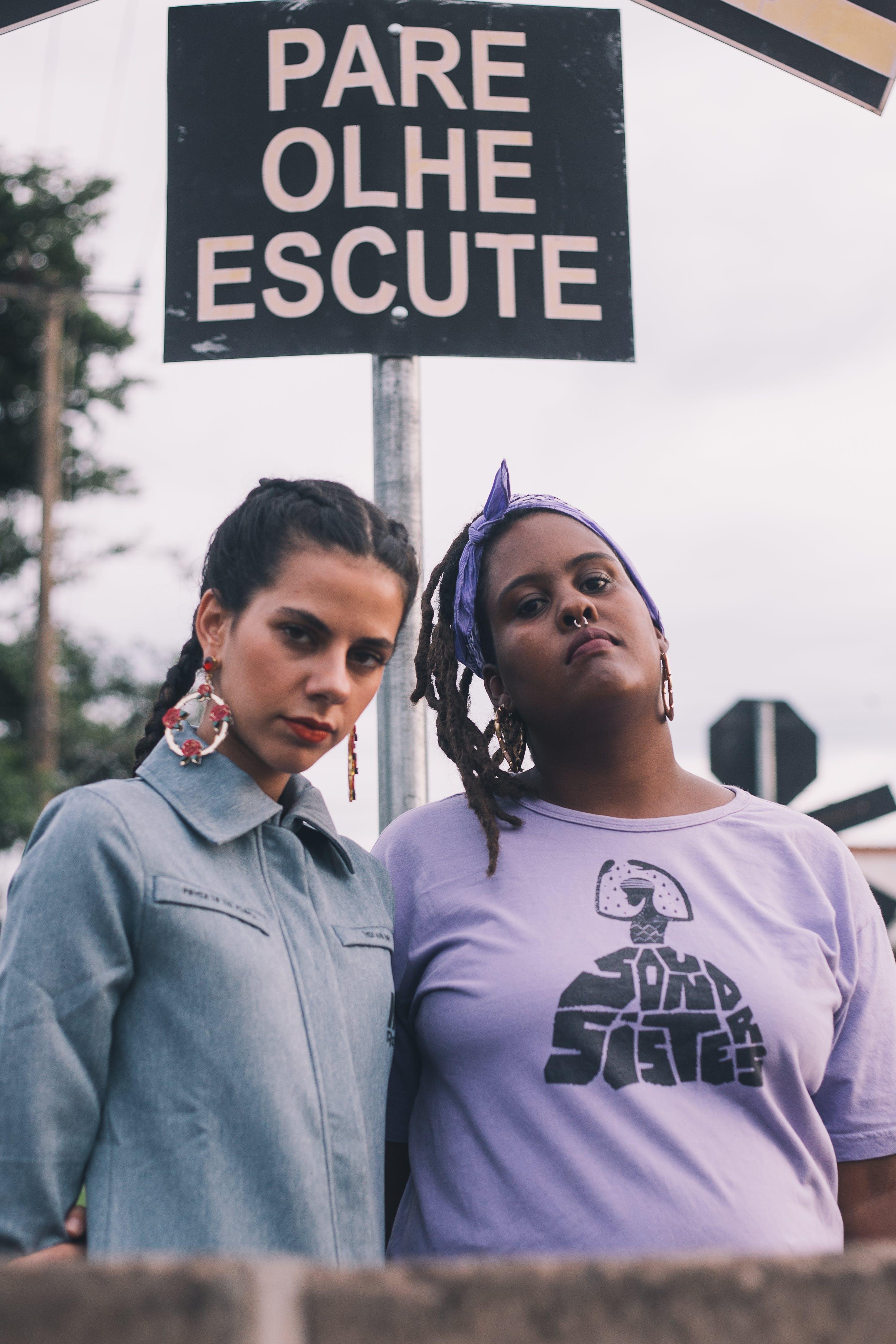 Woman Wearing Purple Scoop-neck Top Beside Woman Wearing Blue Denim Collared Top