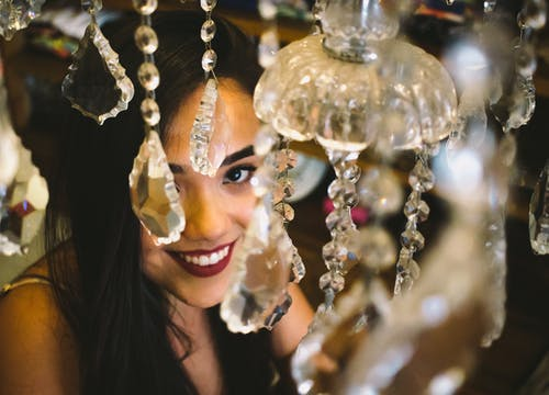 Woman Smiling and Holding Gold String Lights