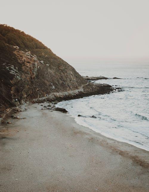 Photos gratuites de aube, baie, bord de mer, côte