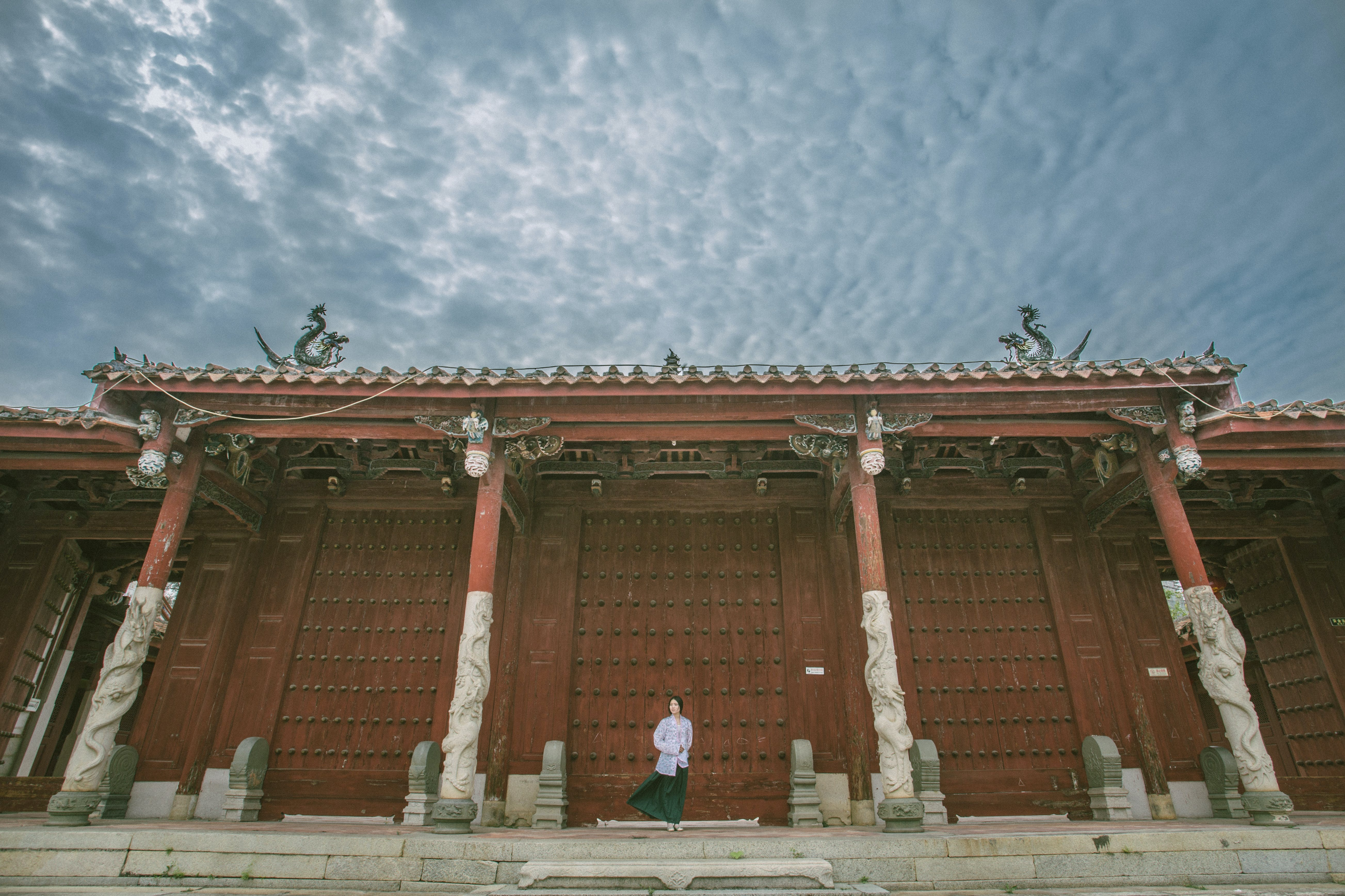 Person Standing Near Red Gate