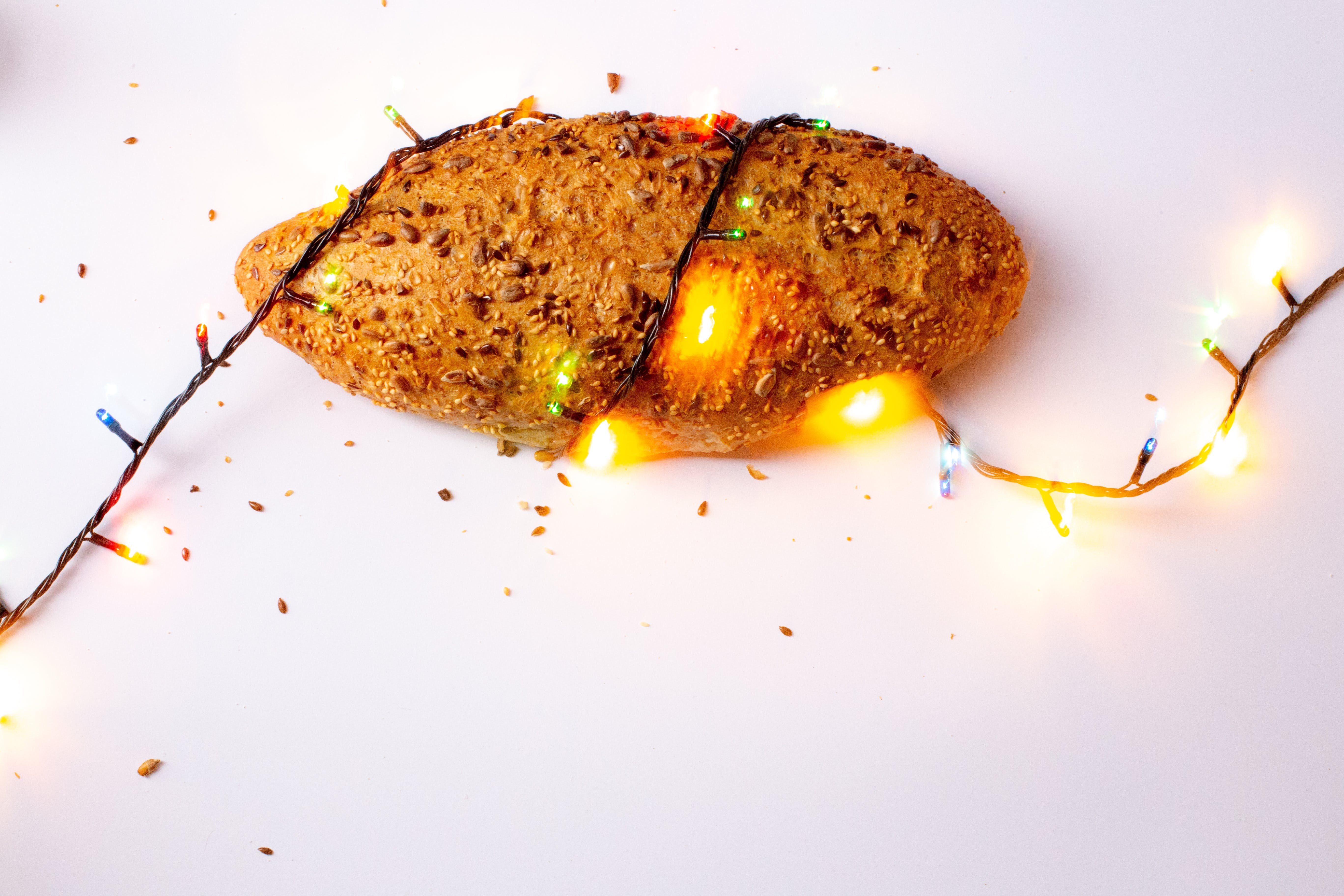 Brown Bread With String Light on White Surface