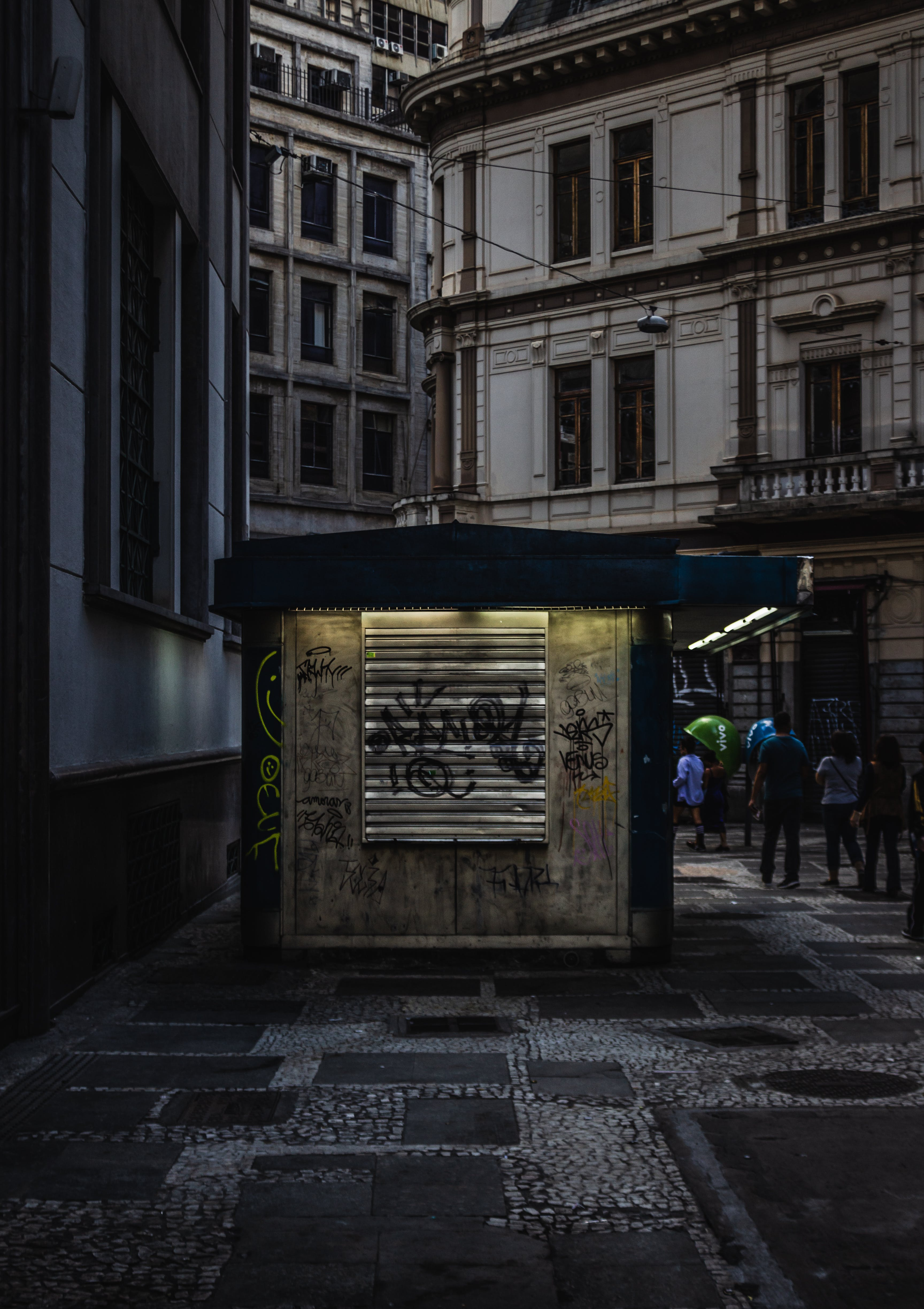 Low Light Photography of People Walking Near Building