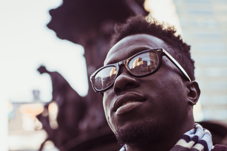 Selective Focus Photo Of Man Wearing Black Framed Sunglasses