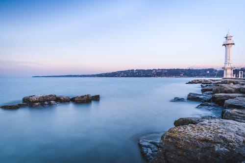 Foto profissional grátis de exposição longa, inverno, mar aberto, pôr do sol