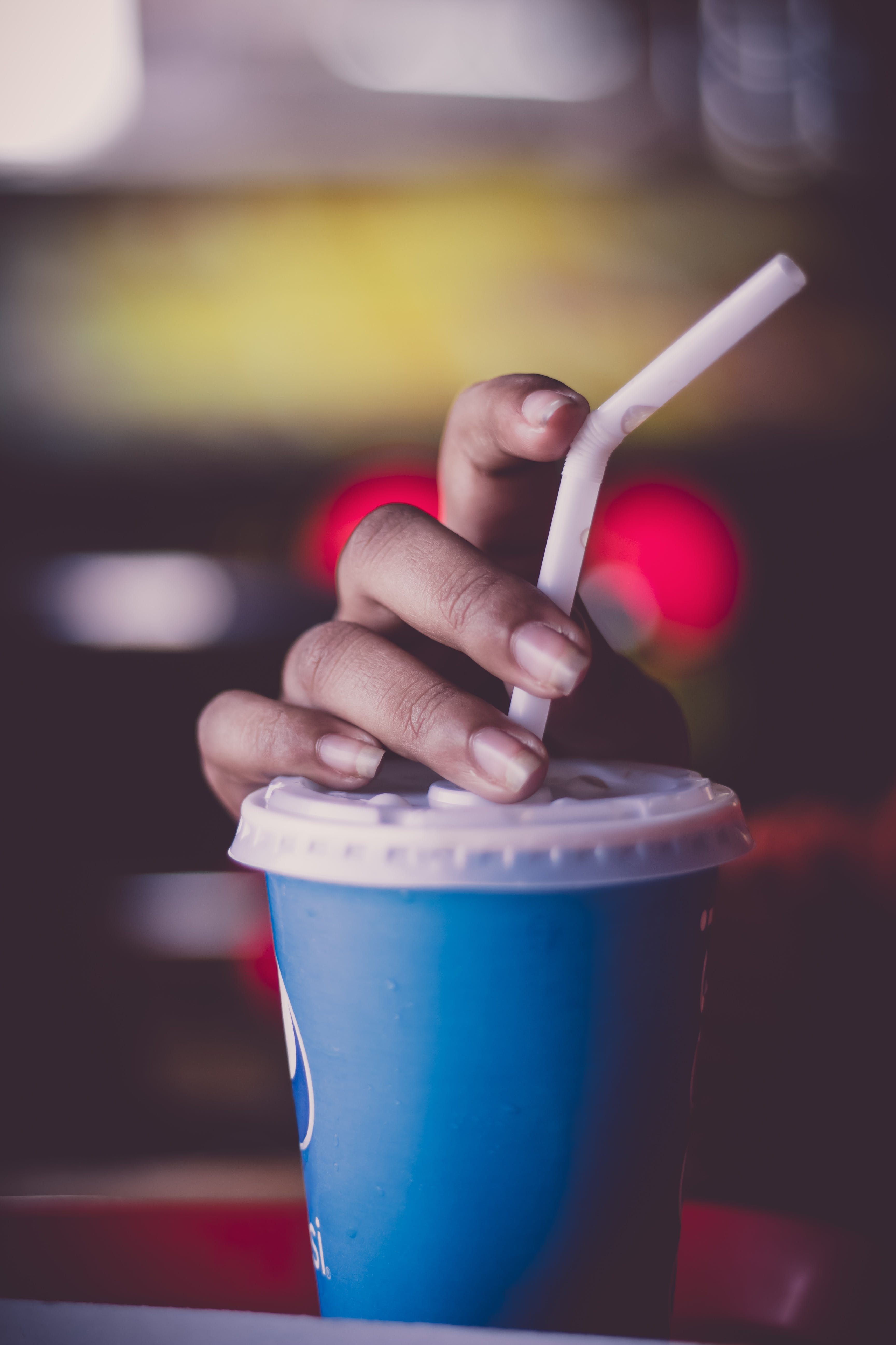 Person Holding Cup With Straw