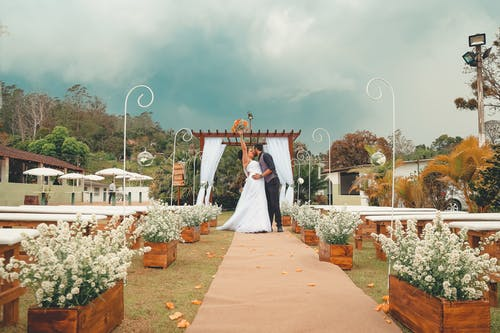 Selective Focus Photography of Newly-wedded Couple Kissing Each Other