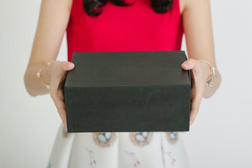 Person Holding Black Box