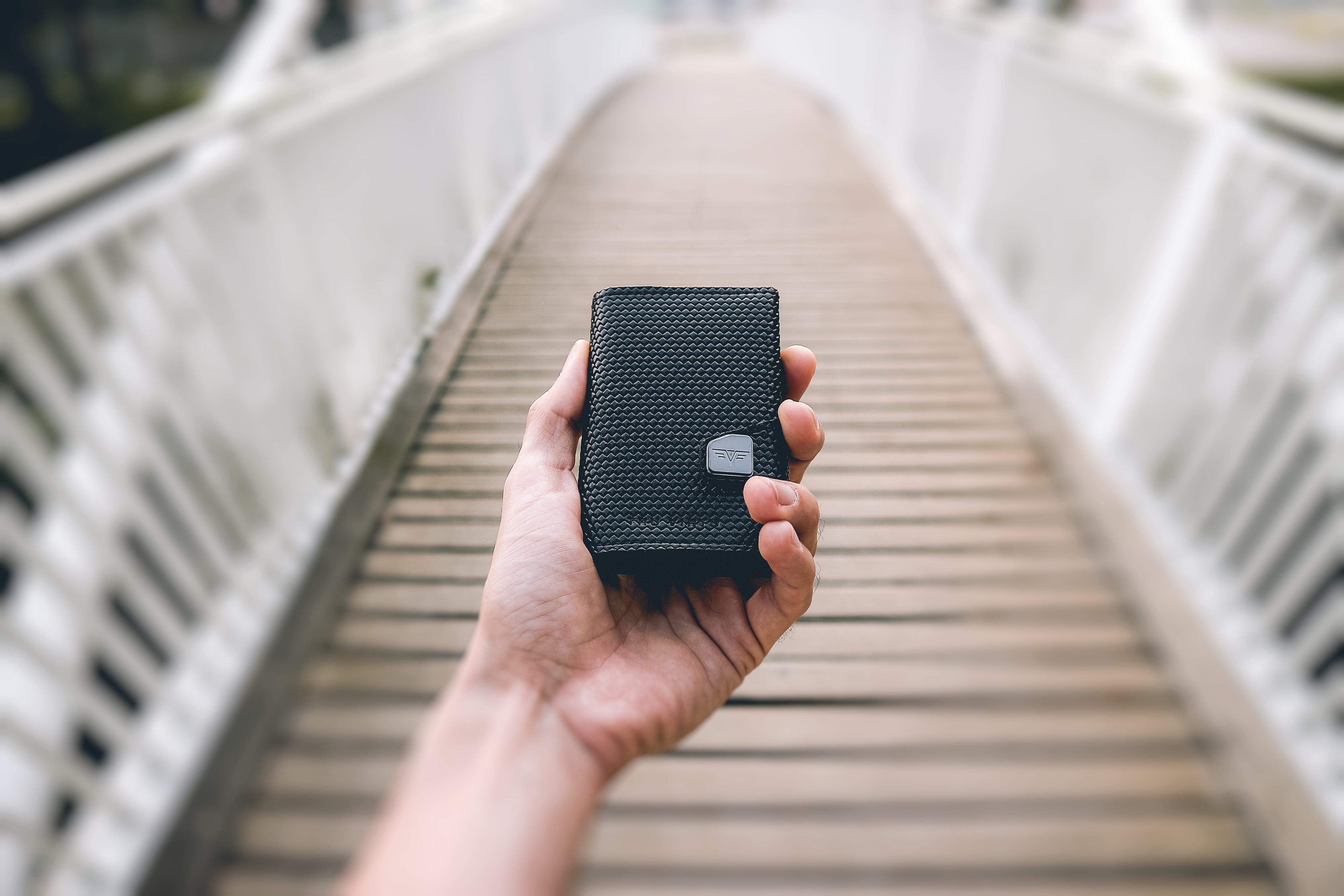 Person Holding Black Portable Speaker