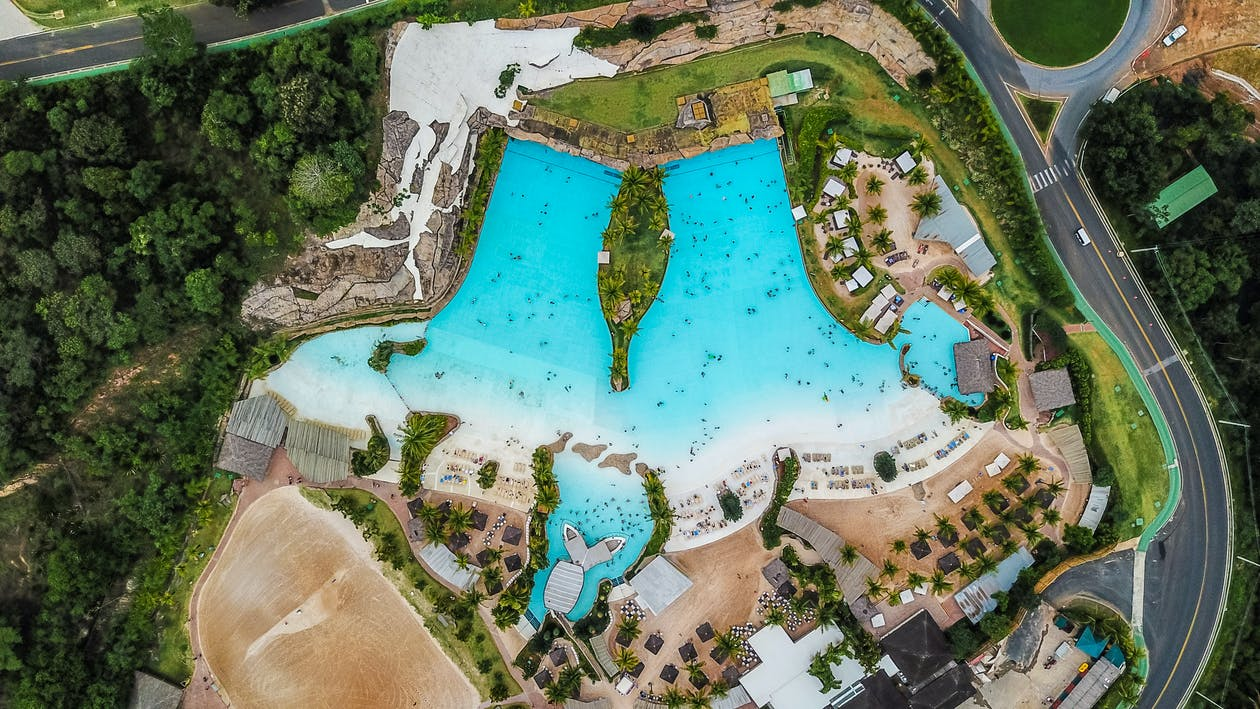 Aerial Photography of Buildings and Pool