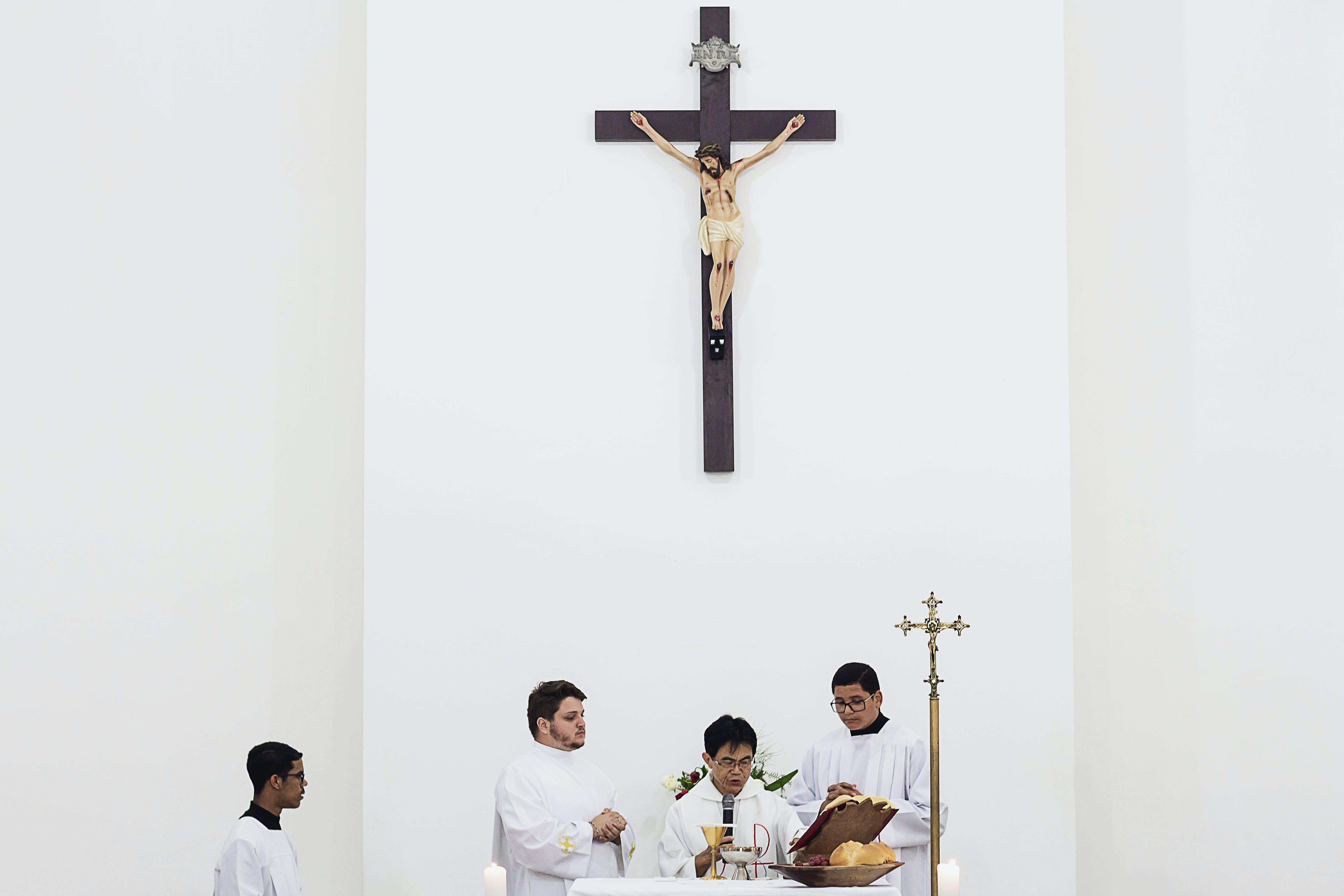 Priest Using Microphone