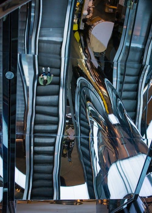 man on a escalator