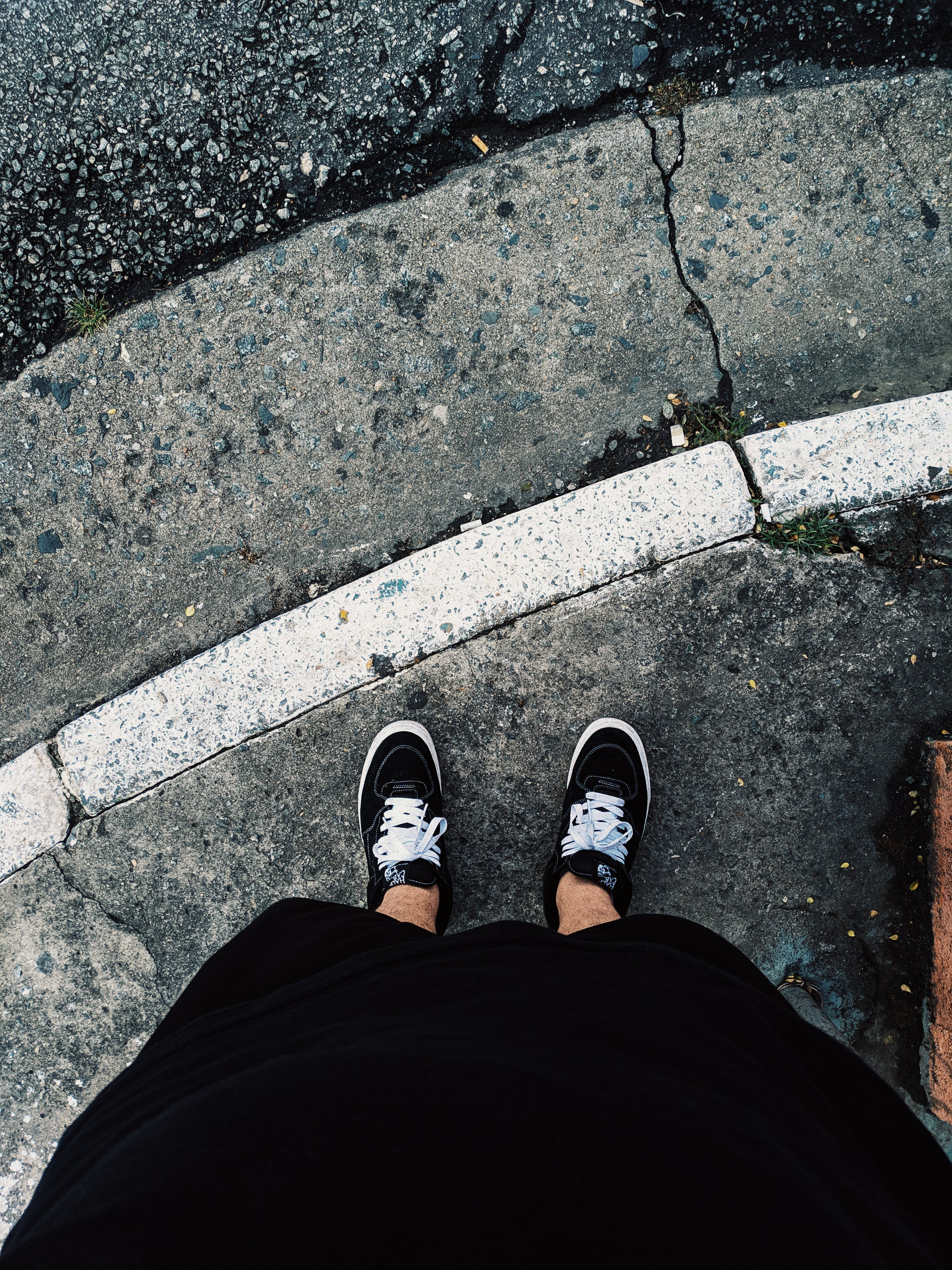 Person Wearing Black Low Top Sneakers