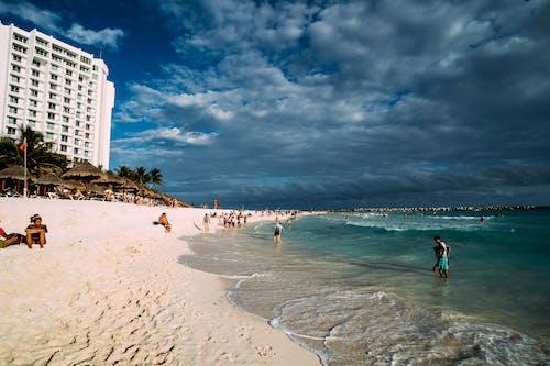 Photo of People On Seashore