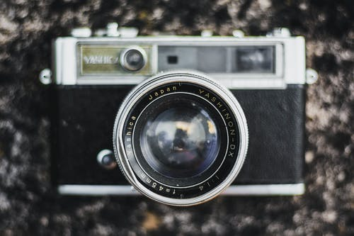 Yashica Camera on Brown Surface