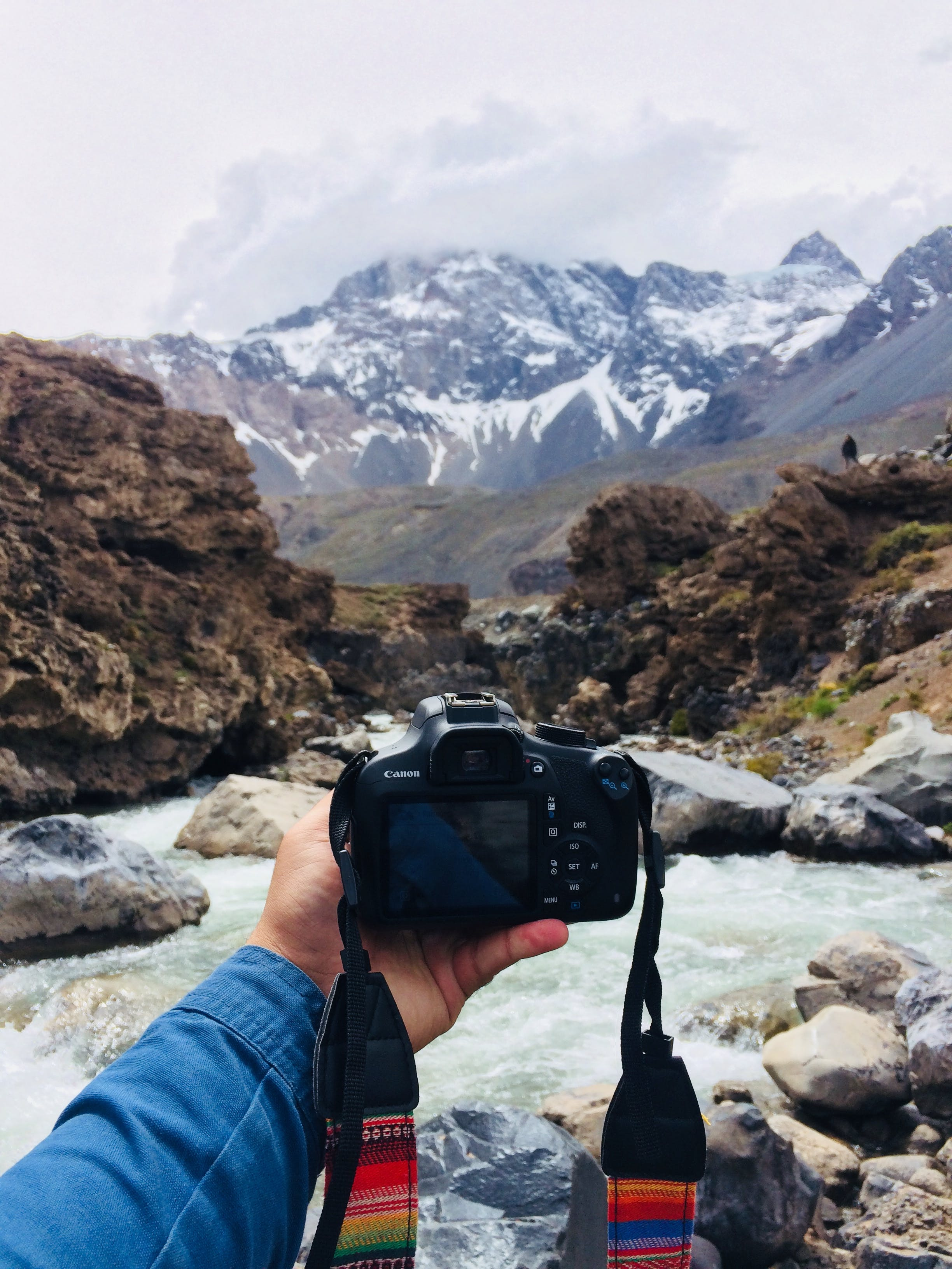 Black Canon Dslr Camera Facing the Mountains during Day