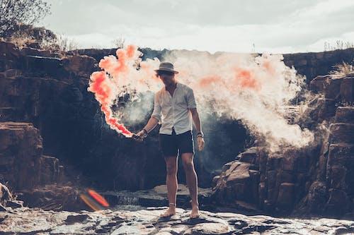 Standing Man Holding Smoke Bomb