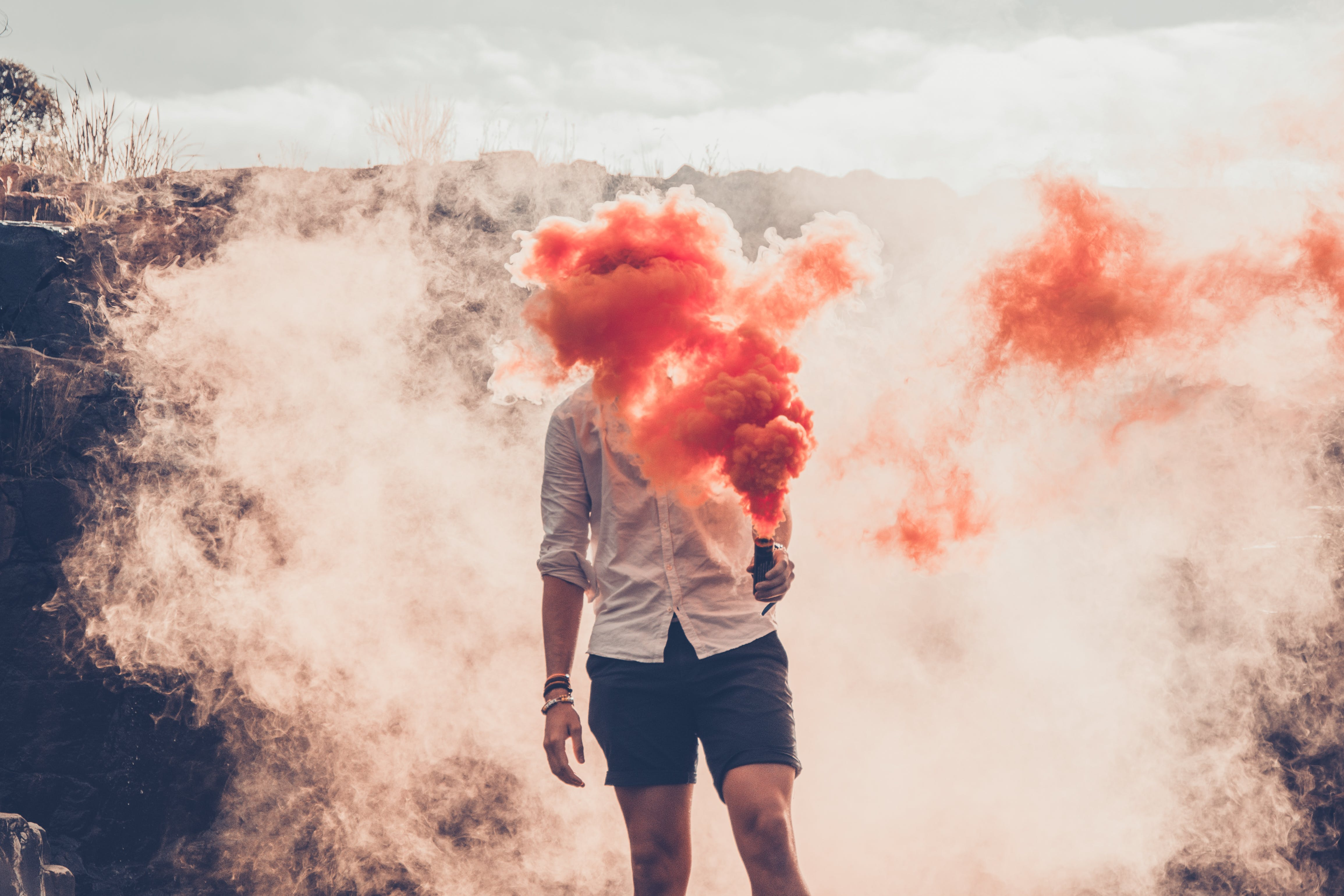 Person Standing While Face Covering With Smoke